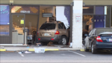 Gallery: Car runs into laundromat, injures employee - (9/11)