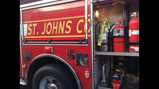 Person escapes car after driving into St. Johns retention pond