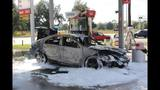 Car with lit candles inside starts on fire at gas station_6236230