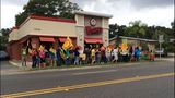 Dozens march outside Wendy's_8419238