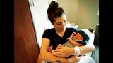 Amy Buckley holds her newborn son for the first time_8542844