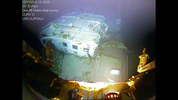In this photograph released by the National Transportation Safety Board on Sunday, Jan. 3, 2016, the detached navigation bridge of the sunken freighter El Faro is seen on the seafloor, 15,000-feet deep near the Bahamas. The freighter sunk on Oct. 1, 2015, after losing engine power and getting caught in a Category 4 hurricane. All 33 crew members aboard were lost at sea. Federal investigators are considering launching another search of the wreckage of a freighter. (National Transportation Safety Board via AP)