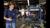 Mechanic Carlos Fernandez tests a generator that was brought in for repair at Blast Off Equipment in West Palm Beach.