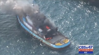 Tugboat towing barge catches fire east of Matanzas Inlet