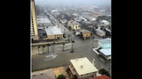 View from a Jacksonville Beach hotel shows storm surge rushing into the streets.