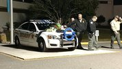 A memorial quickly grew on Deputy Oliver's car.
