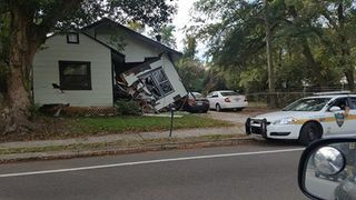 Truck plows into house, stops close to sleeping homeowner