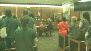 Woman accused in 1998 baby abduction in court