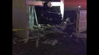 Truck slams into apartment complex