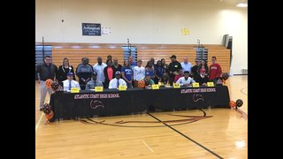 High School athletes committing to schools on National Signing Day