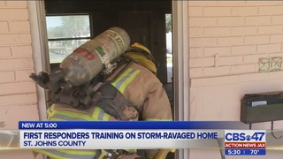 First responders training on storm-ravaged home