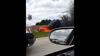 Photos: Taxi catches fire on I-295