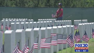Jacksonville National Cemetery sees biggest turn out ever to place flags…