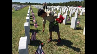 Photos: Boy Scouts lay roses at Jacksonville National Cemetery