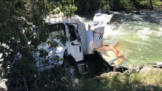 Postal Express truck crash sends boxes of medical supplies into creek