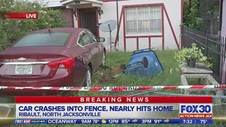 Car crashes through fence, nearly hits Jacksonville home