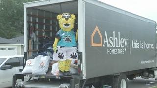 Ashley HomeStore, Jacksonville Jaguars deliver new beds to 200 children