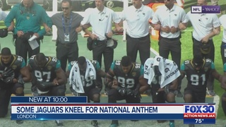 Fans react after Jacksonville Jaguars take a knee, lock arms during…