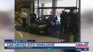 Car drives through Jacksonville Winn-Dixie