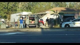 Authorities conducting raid at Northwest Jacksonville auto shop