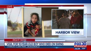 Vigil for 10-year-old who died on swing