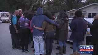 Vigil for murdered family