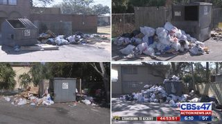 Trash piled up at dumpsters around Jacksonville apartment complex