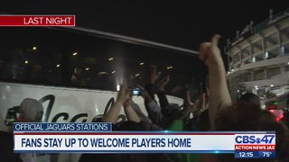 Fans stay up to welcome players home