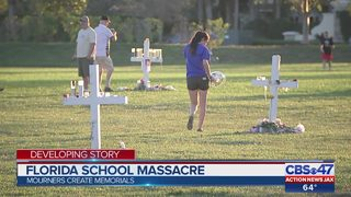 Mourners create memorials to victims of school shooting