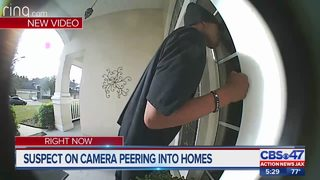 Suspect caught on camera peering into homes