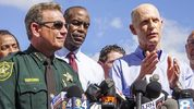 Broward County Sheriff Scott Israel and Broward County Schools Superintendent Robert W. Runcie listen as Florida Gov. Rick Scott speaks during a press conference outside Marjory Stoneman Douglas High School Feb. 15. 2018.