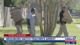 Neighbors watch teacher's arrest