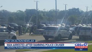 Man arrested after ramming police cruiser