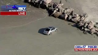 Car, people stranded as tide rises at Huguenot Beach