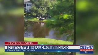 Boy critical after being pulled from retention pond