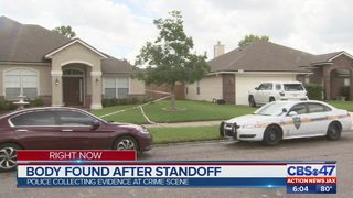 Body found after standoff