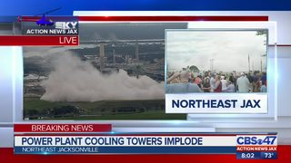 Former employees at the Jacksonville cooling towers watch implosion