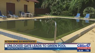 Unlocked gate leads to green pool