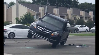 Photos: Mercedes SUV, Dodge pickup collide on St. Johns Bluff