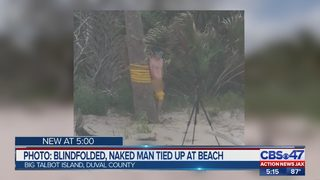 Photo appears to show naked man tied to tree at Big Talbot Island State Park