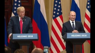 With Putin, Trump calls Russia probe a 'disaster