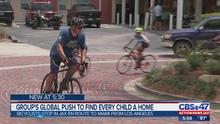 Group of bicyclists riding for adoption awareness stops in Jacksonville