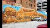 A Sleeping Buddha by Cal Oglesby, 118 N Julia St, Photo Credit: Jacquelinemhadel.com