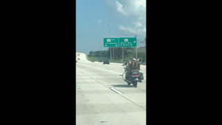 Video: Shirtless, shoeless man seen on I-95 in Jacksonville driving a Harley with his feet