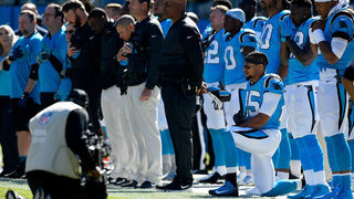 Panthers salute service members; safety Reid kneels during anthem