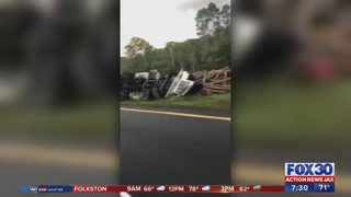 Fatal crash involving an overturned log truck