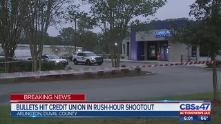 Bullets hit credit union in rush-hour shootout