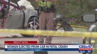 Woman ejected from car in fatal crash