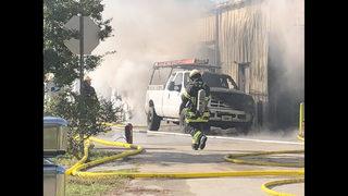 Photos: Auto repair shop catches fire near Beach Blvd.