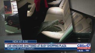 Car windows shattered at busy shopping pizza
